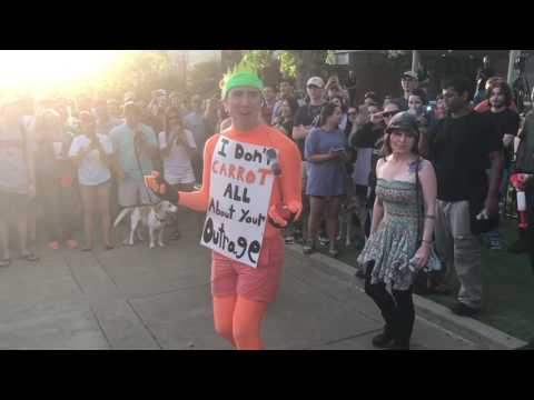 Protesters square off with carrot man at Auburn University