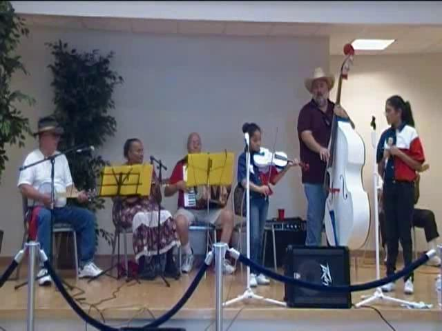 Texas Fiddlers & Cloggers playing & Clogging to Oh Susanna