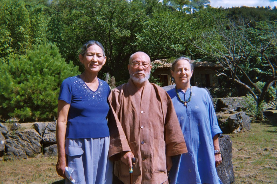 With Korea's National Shaman Kim Keumhwa (left) and the Sunim abbot of the Buddhist temple at the base of Halla-sa Volcano/Mountain on Jeju-do.