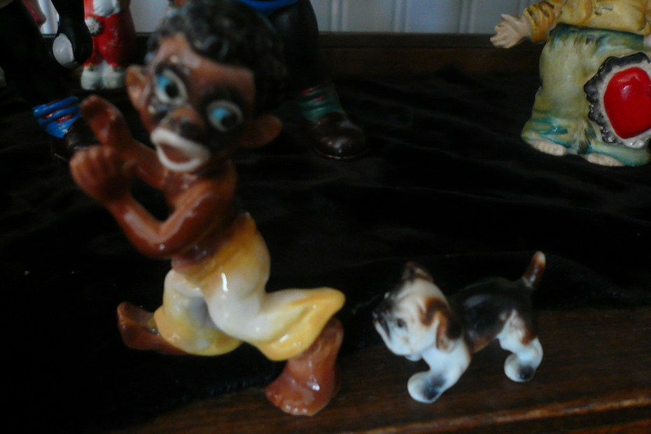 sambo getting chased by dog figurines
