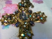 Close up of beautiful and rare stamped Tammey jeweled cross gold plated