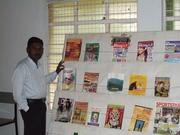 V. Senthur Velmurugan in Front of Periodical Display Rack
