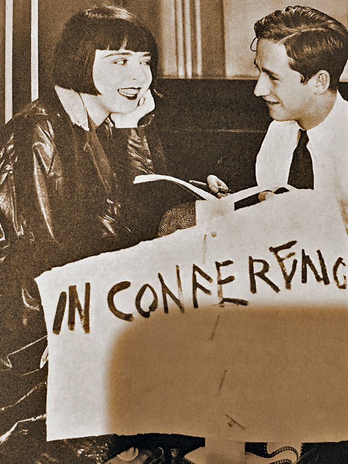 Colleen Moore visiting with close friend Director Mervyn LeRoy on the set of OH KAY! in 1928