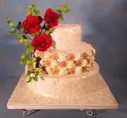 Billowed tufted cake,gum-paste flowers