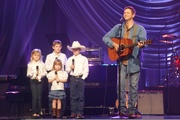 Greg McDougal and his four little miracles!