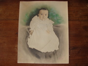 19th or early 20th century Baby in baptismal gown or white dress