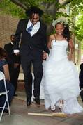 "Our beautiful couple jumping over the ""King & Queen Eternal"" wedding broom!"