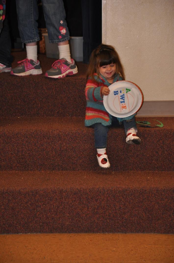 Lovely little girl enjoying her home made shaker