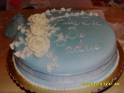 Blue cake with white roses