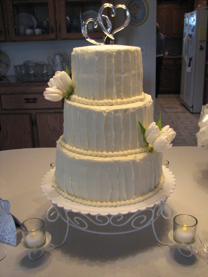 3 tiered Red velvet wedding cake with cream cheese icing with real tulips
