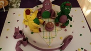 Barney and friends on a birthday picnic cake!