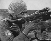 Werhrmacht solider from India operating a MG34