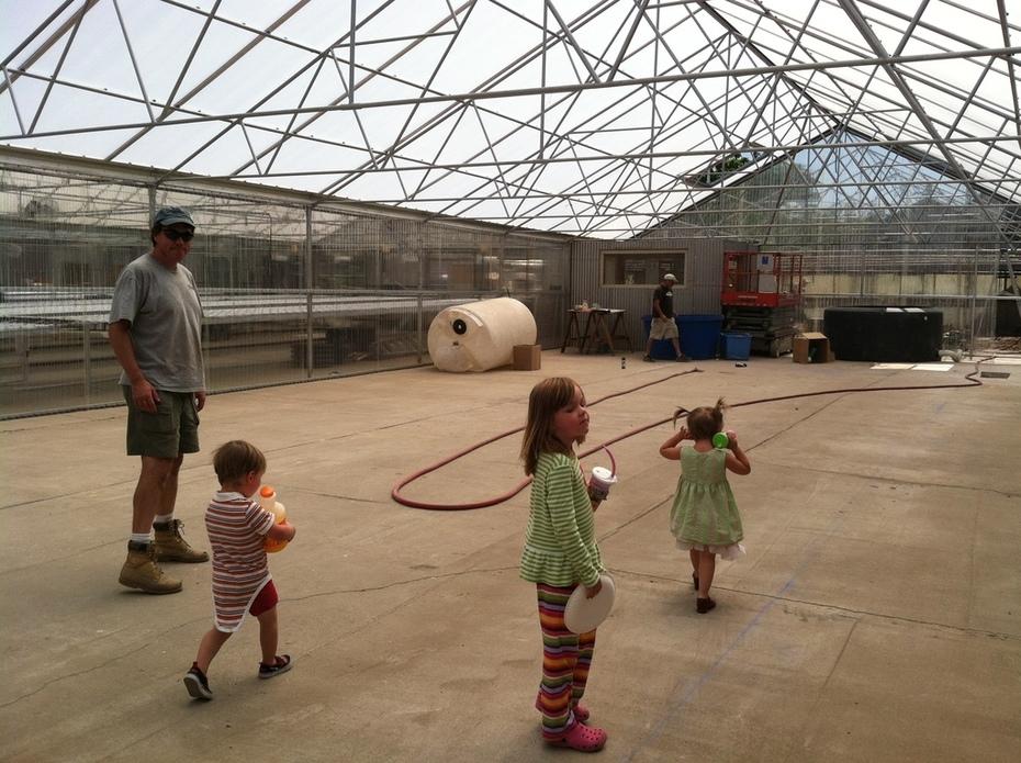 Sawyer kids helping JD (Dad) at the GrowHaus