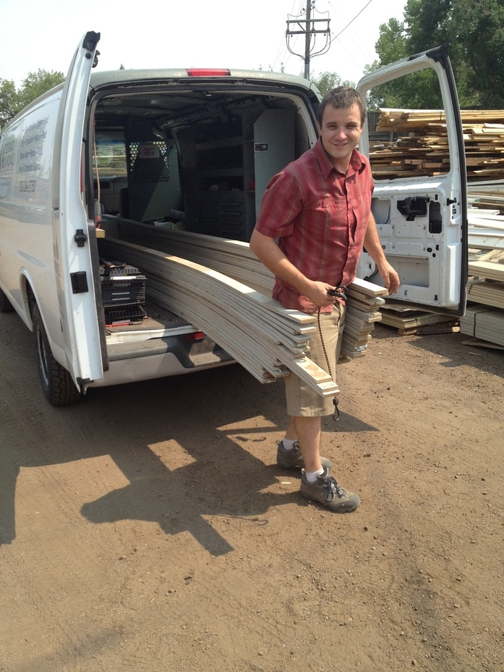 Shawn unloading lumber for the Aquaponics system at GrowHaus