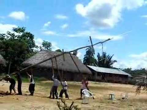 Raising the antenna mast in a Kichwa village