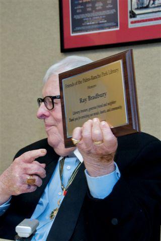 Bradbury holding Friends' plaque