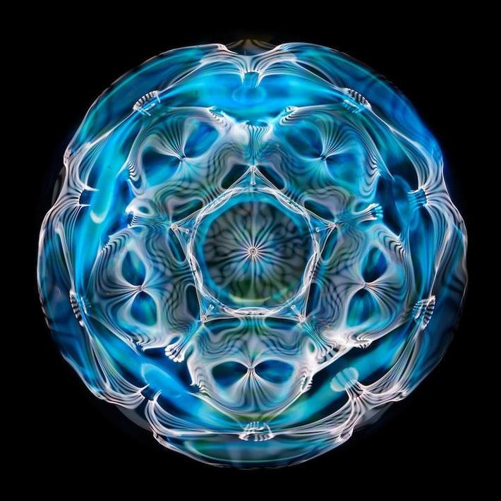 Cymatics photo of light water and sound