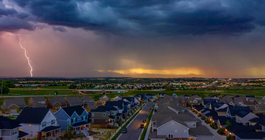 Lightning against the Flatirons at sunset