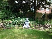 Buddha in the garden off Amida Mandala Temple
