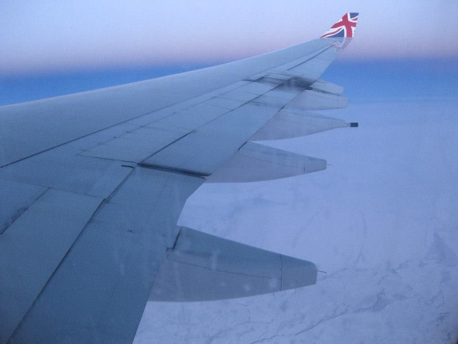 flying out over snowy greenland on Virgin a340