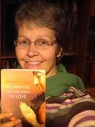Kristin holding up my book