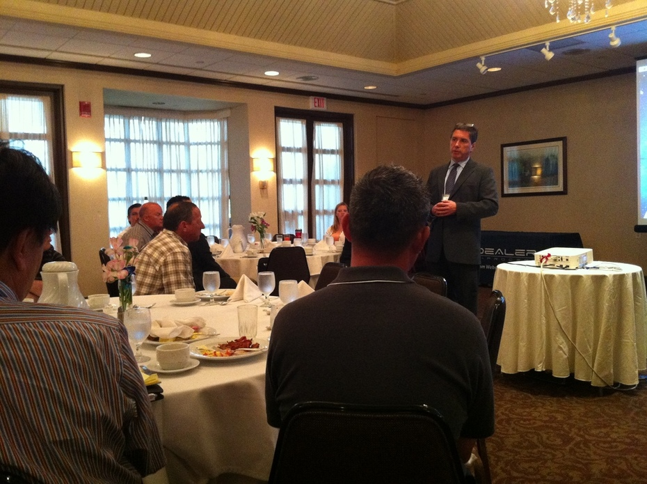 Brian Pasch speaks to PCG Pit Stop audience in New Jersey