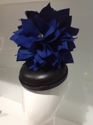 Black leather button with royal blue felt flower