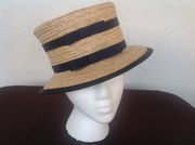 Straw hat with navy ribbon and bows