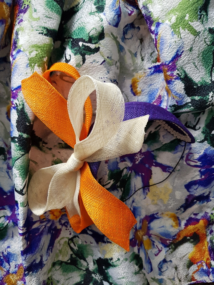 Purple bandeau with orange and white sinamay bows