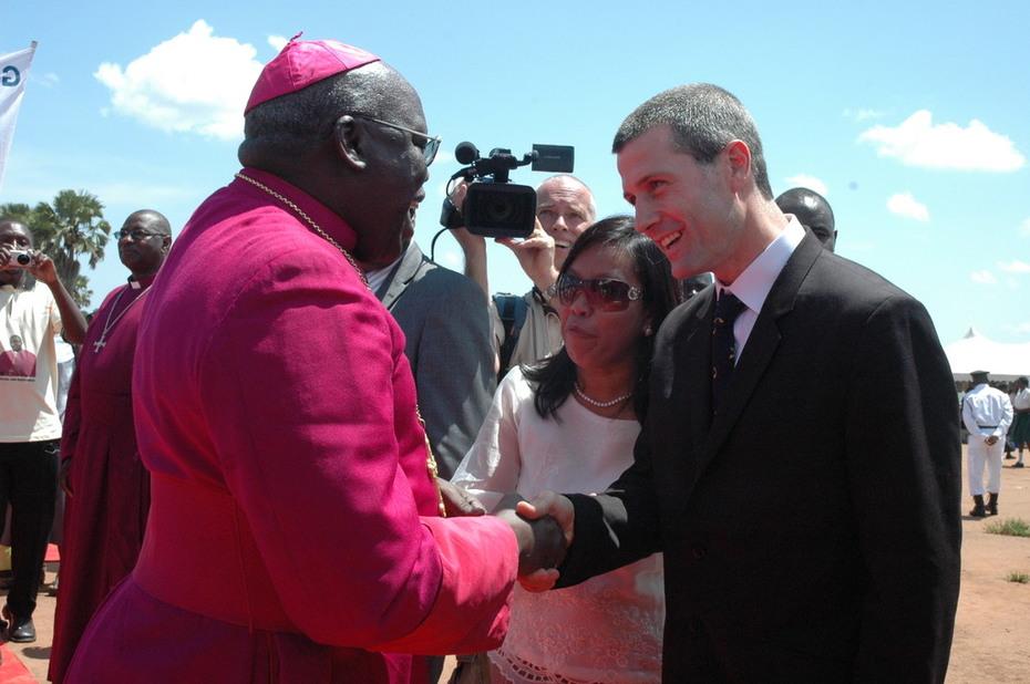 Archbishop Odama greets Matt Scott