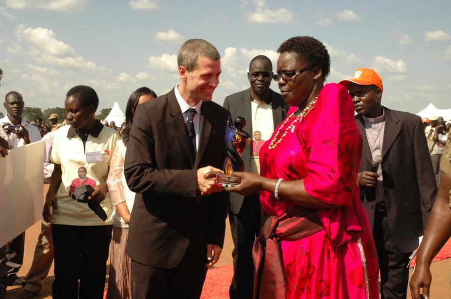 Matt Scott and Hon. Rebecca Amuge Otengo shake hands