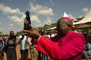 Archbishop Odama hold up his trophy