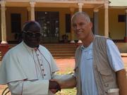 Archbishop Odama shakes the hand of Lutz Hahn, WV Switzerland Videographer