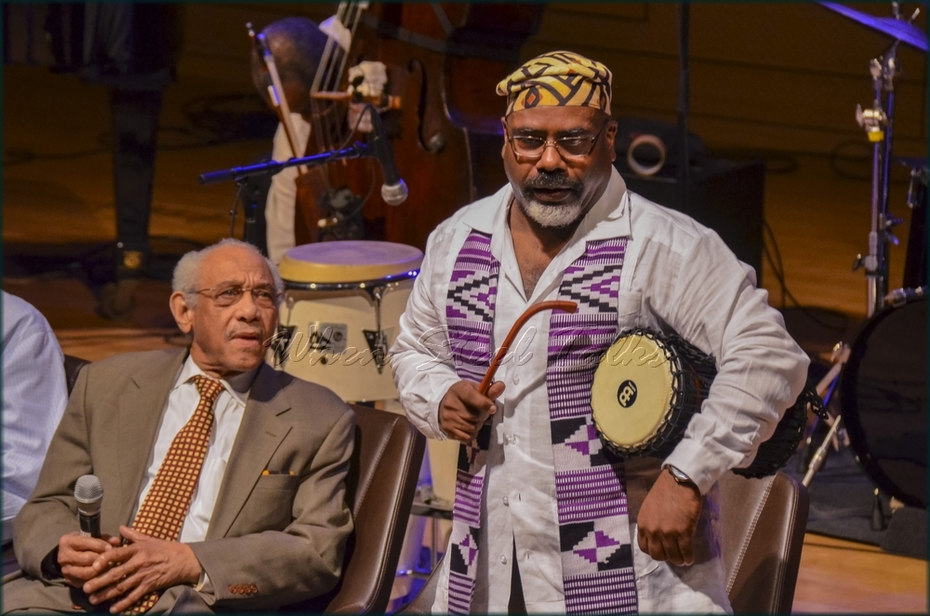 "Dr. Joseph Gaines (standing) from: ""Randy Weston presents Symposium in the Drum - From Africa to the New World"""