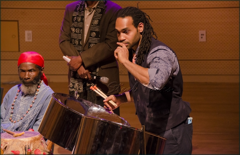 Khuent Rose demonstrates the double second steelpan at the symposium held in the Tishman Auditorium, New School, New York
