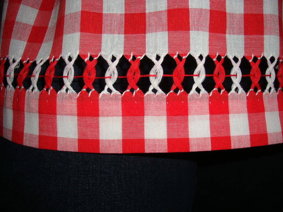 Drawn thread embroidery top closeup
