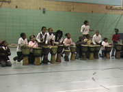 Kids drumming in gym photo