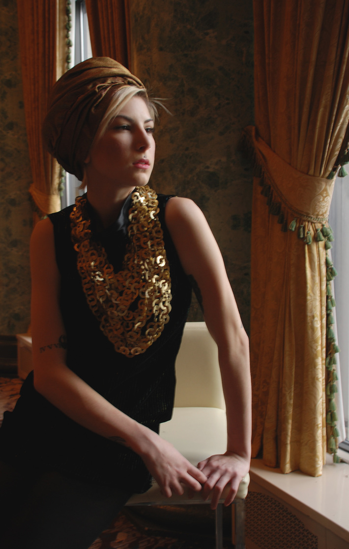 Madeline in gold turban by tonya gross millinery