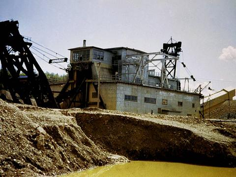 Placer gold dredge working circa 1948