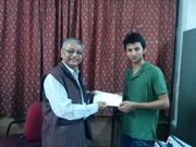 HOD Jamia Hamdard, Department of Computer Science giving the D-Link 1st prize to the winner