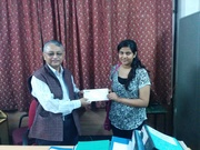 HOD Jamia Hamdard, Department of Computer Science giving the D-Link 2nd prize to the winner