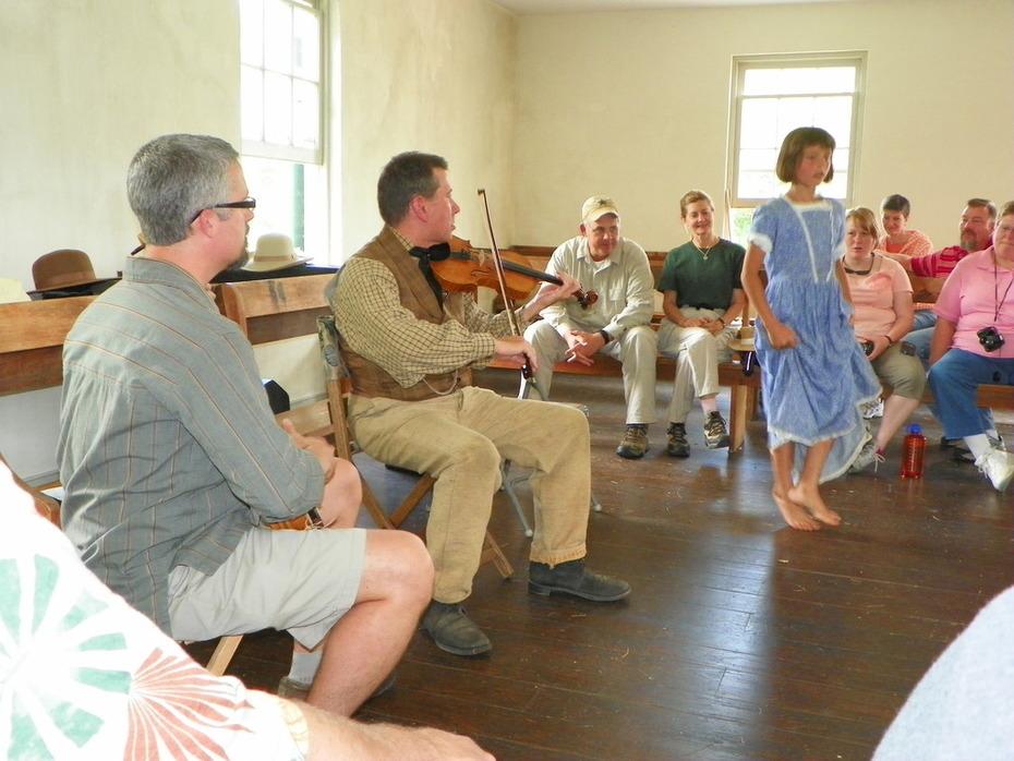 Greg, Chuck, and our little Irish Dancer at the Dunker Church
