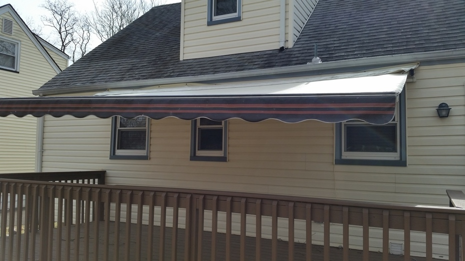 Retractable Awning covering Deck