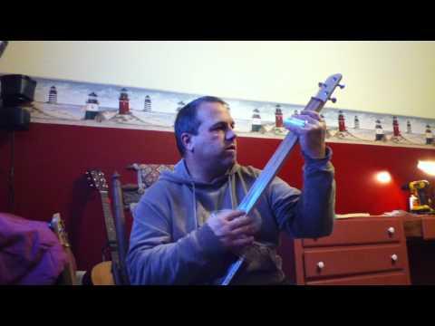 Three string cigar box guitar slide Tony T.