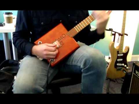 Sliding on a Cigar Box Guitar