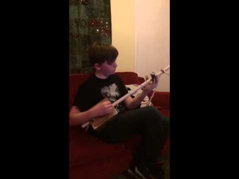 Finn playing diddley bow