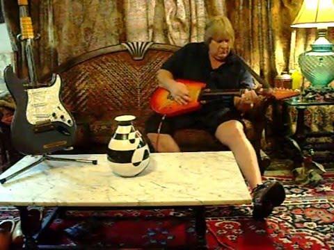 "Wow ! Play a ""Krueger Auto-fret Guitar"""