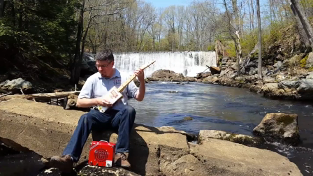 Electric Cigar Box Guitar on the Cocheco River