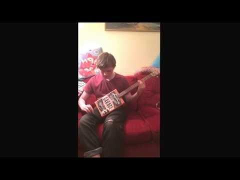 Finn Play testing the Harley Davidson can 4 string guitar
