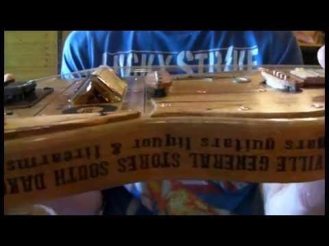 JUNKSVILLE GUITARS THE GLITSCH BOOTLEGGER EDITION RELIC 4 STRING GUITAR WITH JACK  DANIELS BRIDGE